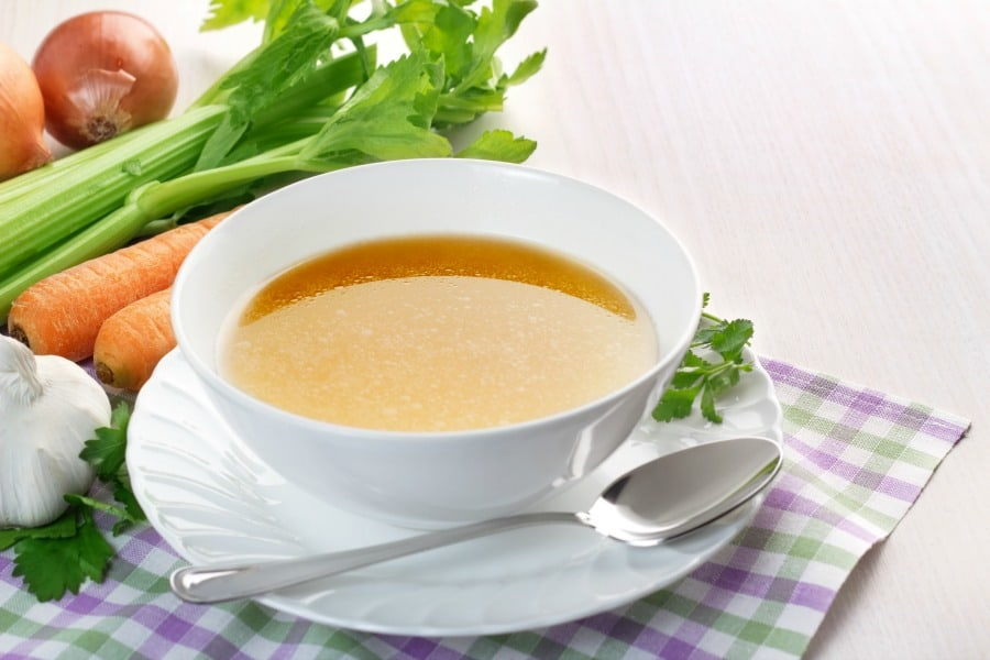 One simple way to make homemade chicken broth. Learn how to simply cook in crock pot and freeze for use in recipes, including Whole30 or otherwise.